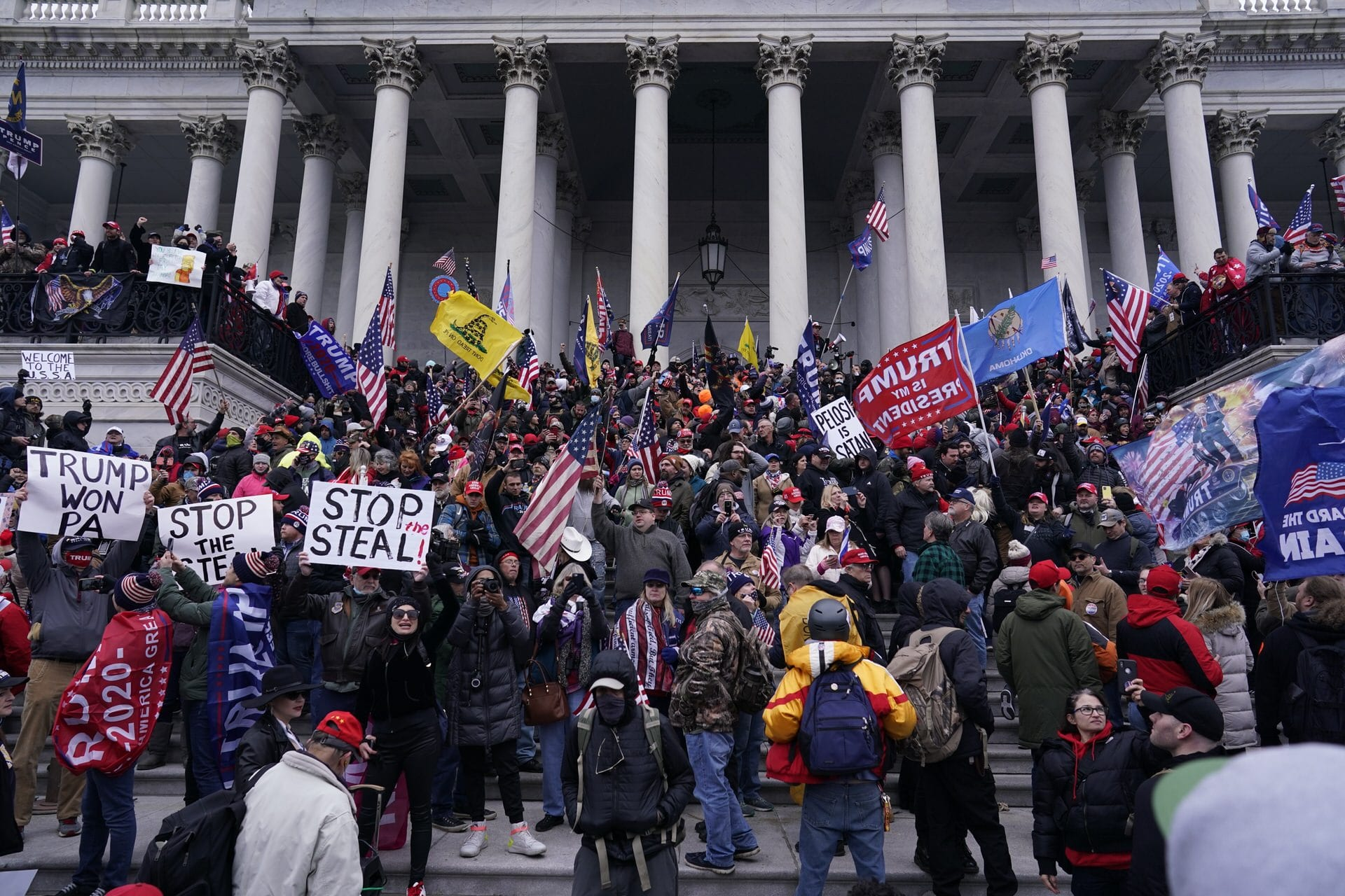 A mob gathers on the steps of the Capitol on January 6.