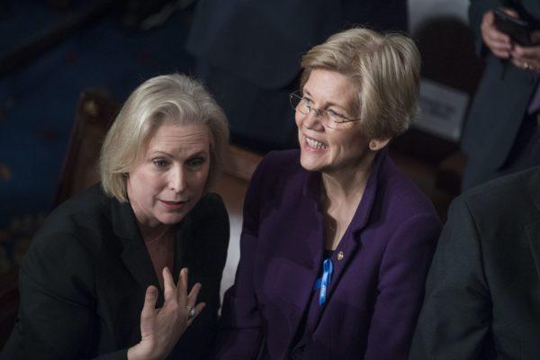 Sens. Kirsten Gillibrand and Elizabeth Warren talk to each other.