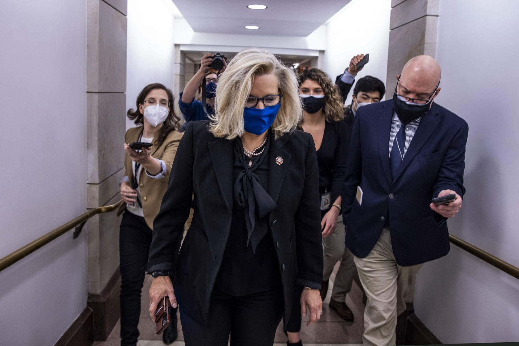 Liz Cheney walks to the House floor to vote on Feb. 3, 2021.