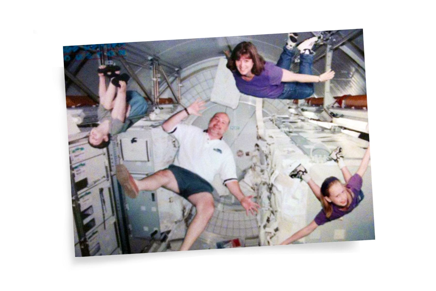 A photo of Hayley Arceneaux floating with her family in a space simulation.