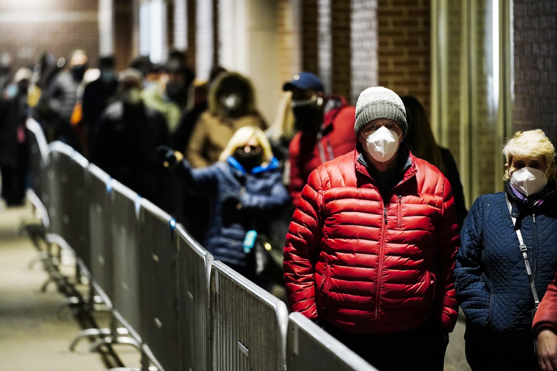 People wait in line at a FEMA Community Vaccination Center at the Pennsylvania Convention Center.