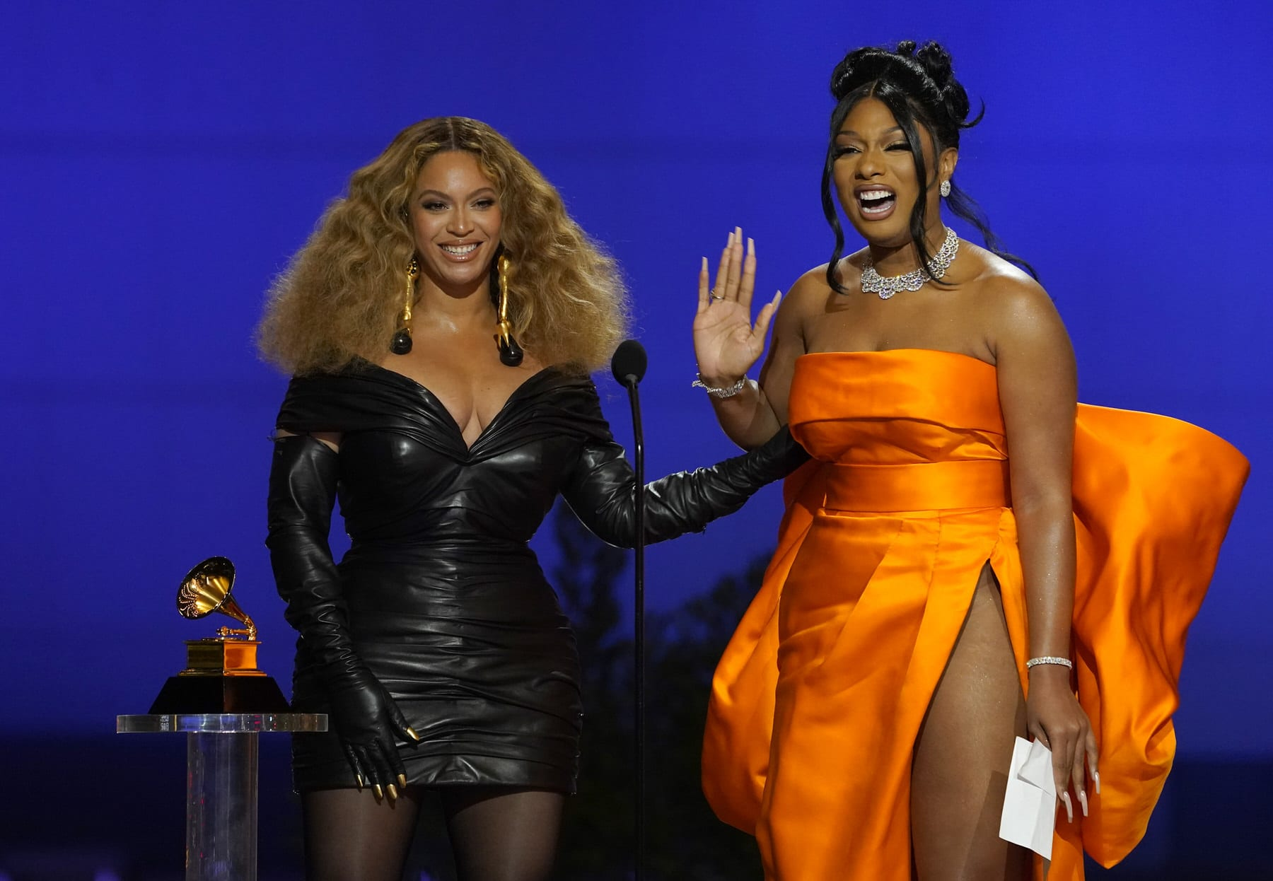 "Beyonce, left, and Megan Thee Stallion accept the award for best rap song for ""Savage"" at the 63rd annual Grammy Awards ."