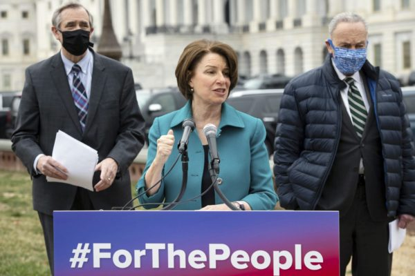 Amy Klobuchar speaks at the Capitol on the For the People Act