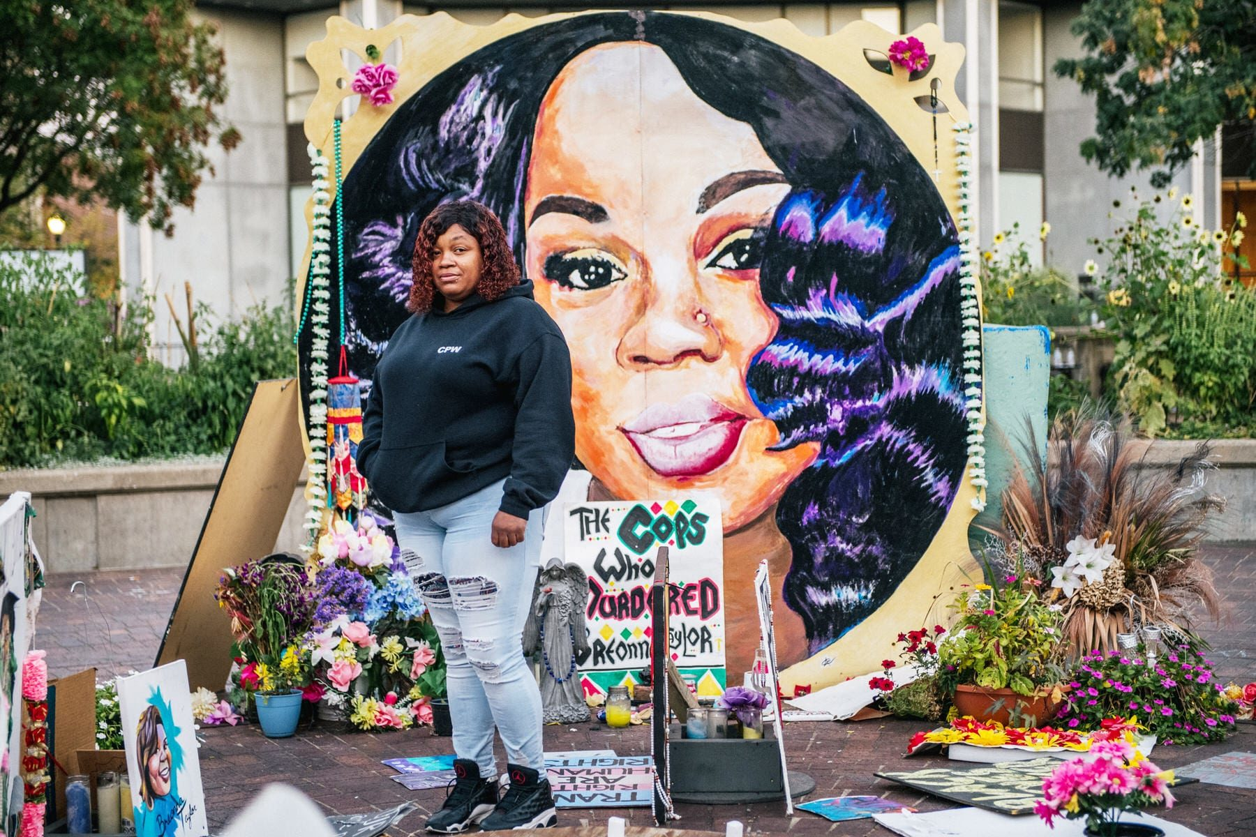 Tamika Palmer, mother of Breonna Taylor, poses for a portrait in front of a mural of her daughter.