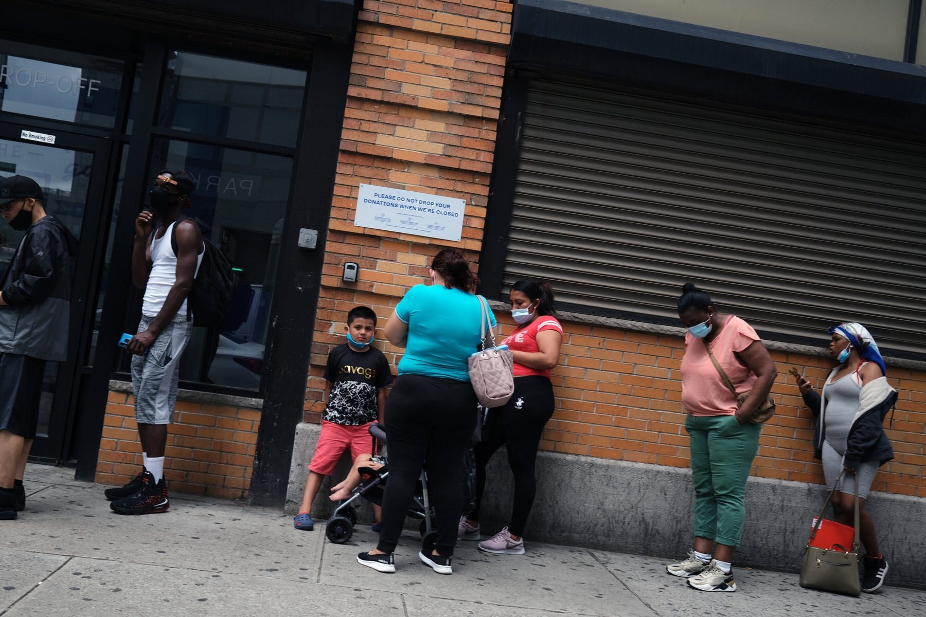 People wait in line for food assistance cards on July 07, 2020 in the Brooklyn borough of New York City.
