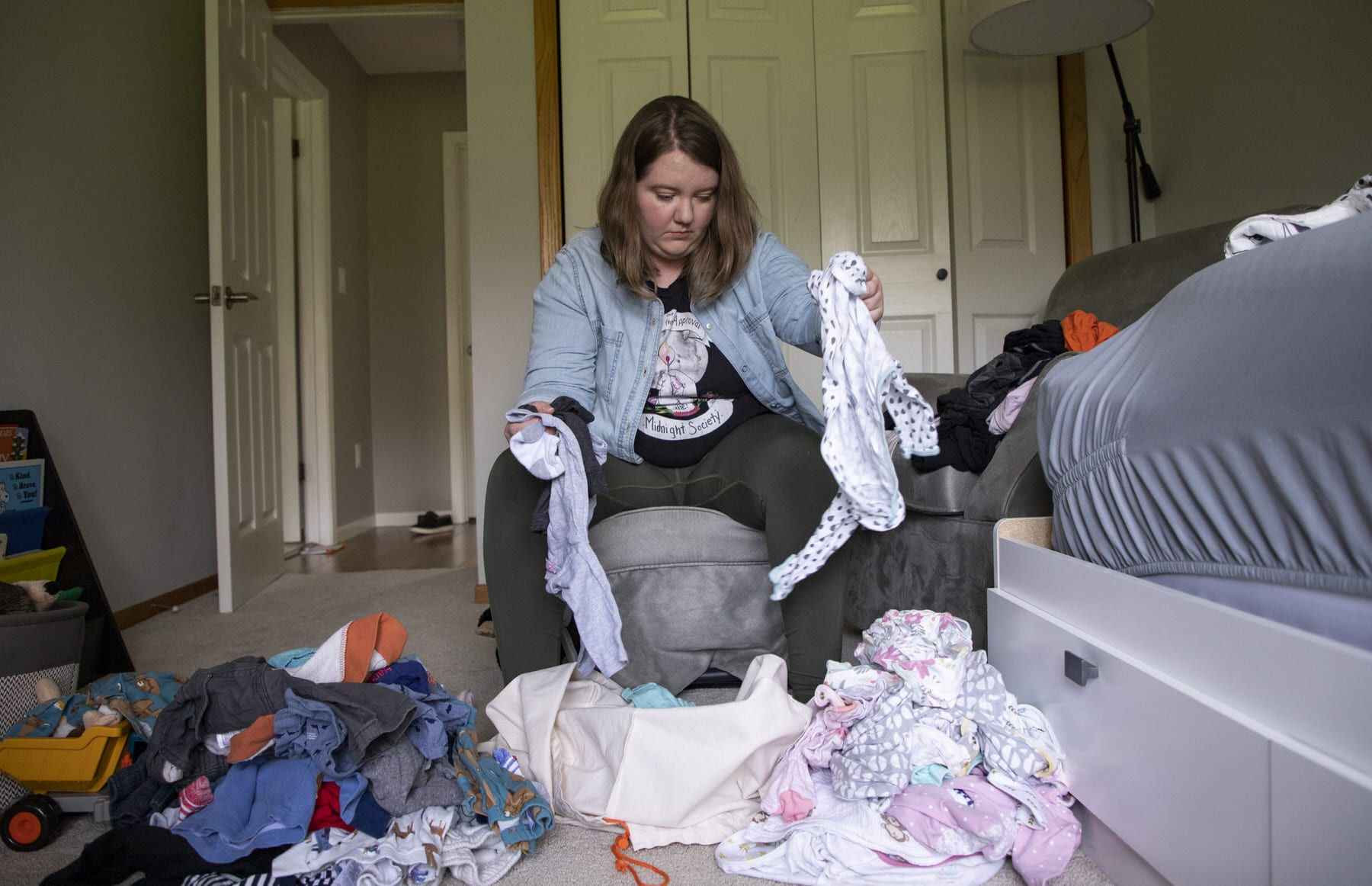 A mother sorts through laundry.