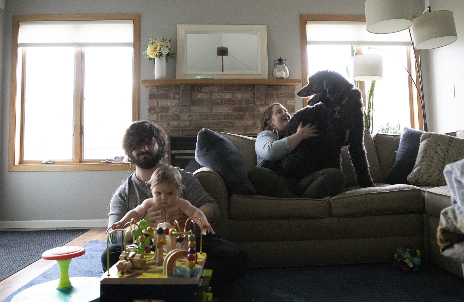 A family visits in their living room.