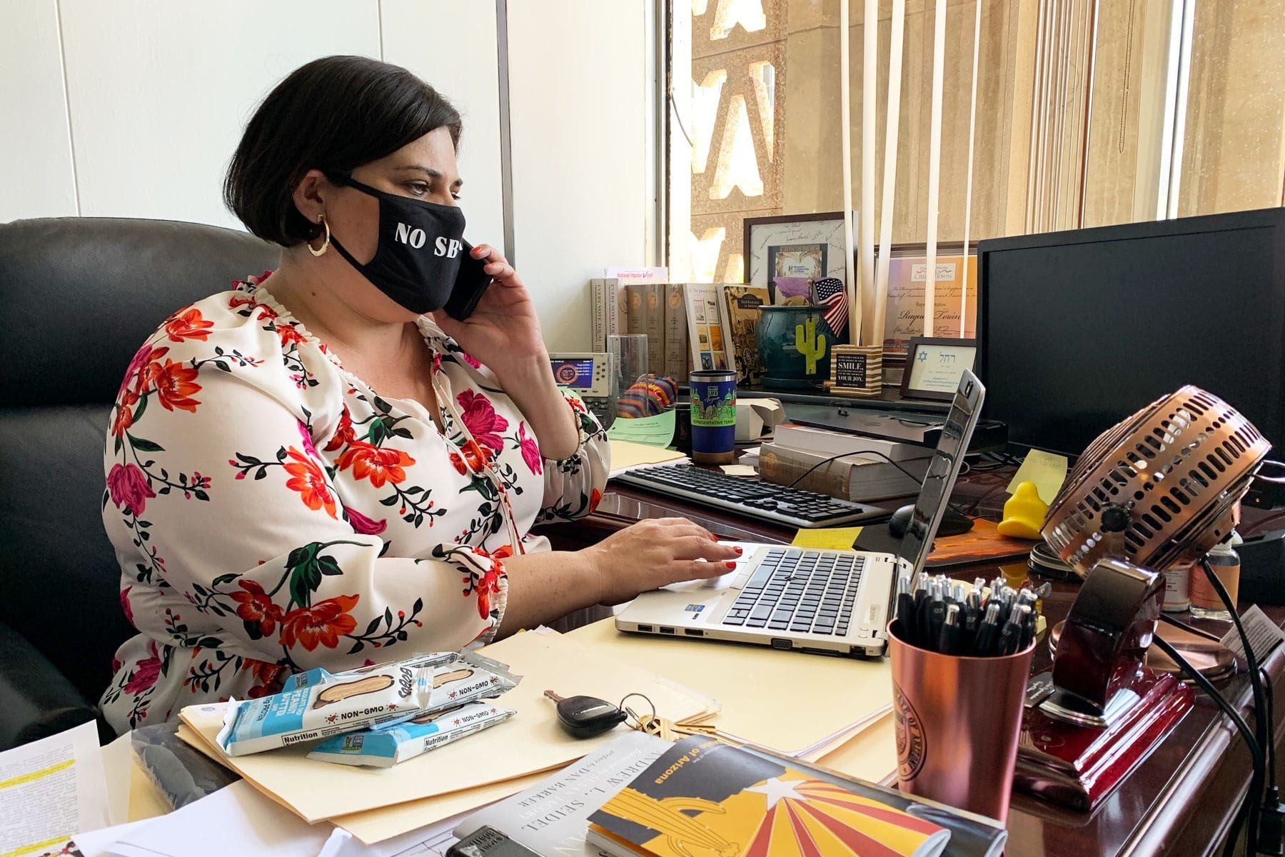Arizona state Rep. Raquel Terán working at her desk.
