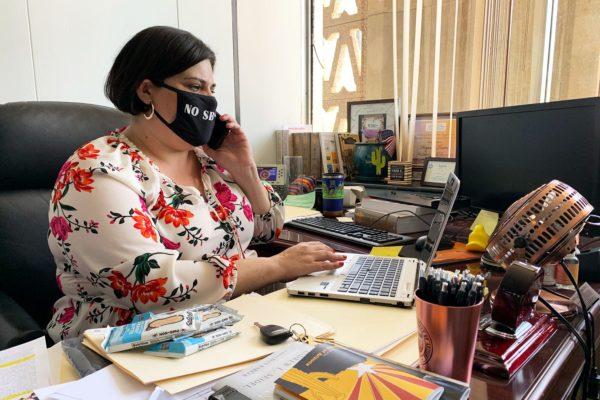 Arizona state Rep. Raquel Terán working at her desk.