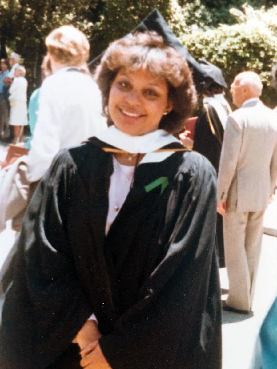 Renel Brooks-Moon in a graduation cap and gown.