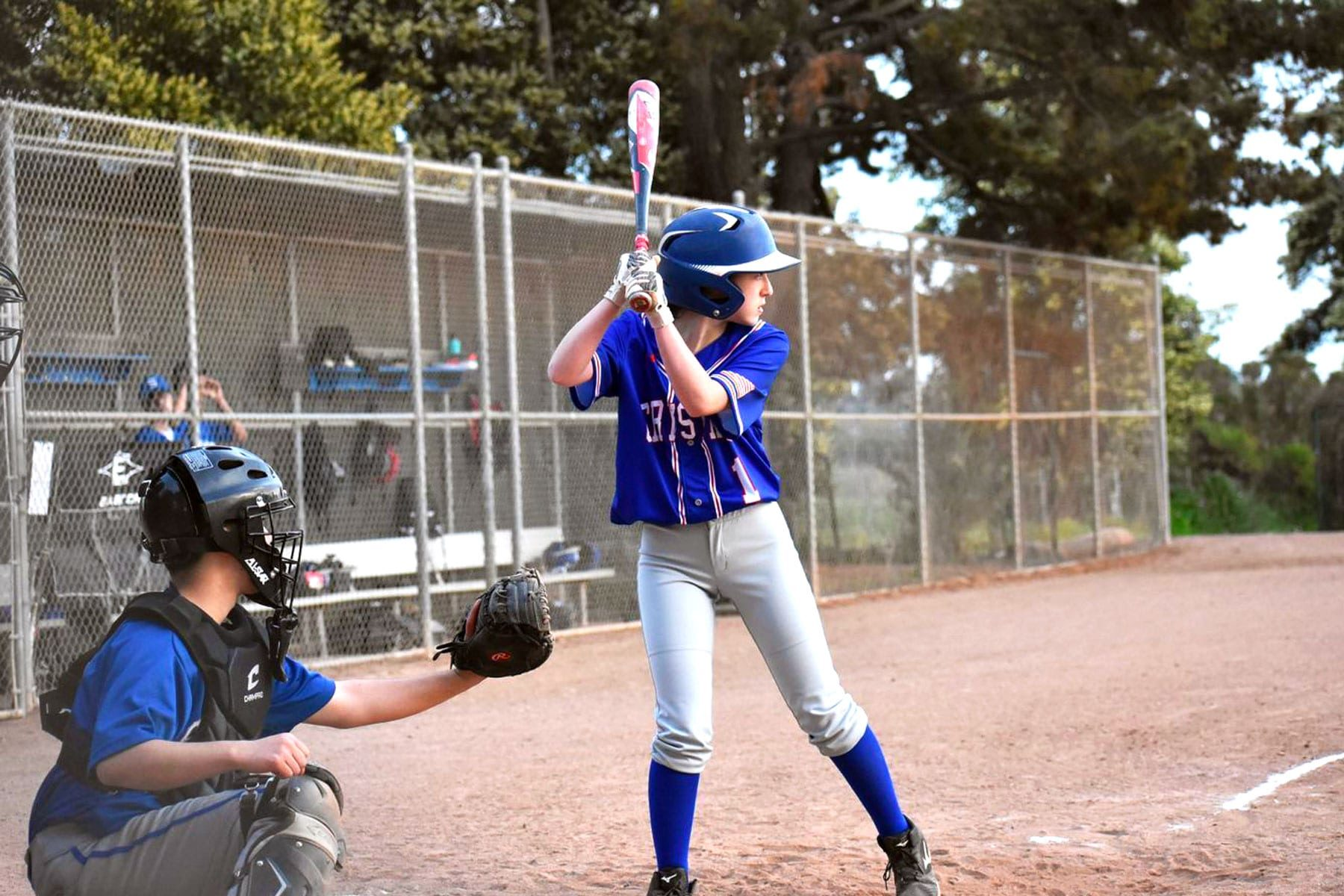 Eliza Schnitzer at bat on a baseball field.