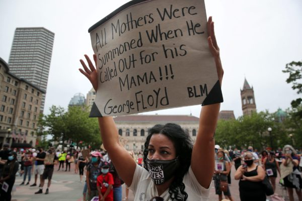 Shellee Mendes, a mother of three, raised her sign during the March Like A Mother for Black Lives rally at Copley Square in Boston, MA on June 27, 2020. Organizers say the peaceful, family-friendly event was created in response to the murders of George Floyd, Breonna Taylor, and Ahmaud Arbery to empower mothers to stand in solidarity against racism and anti-blackness while demanding radical systemic change.