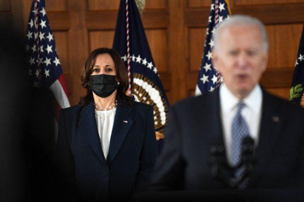 Vice President Kamala Harris stands while President Joe Biden speaks