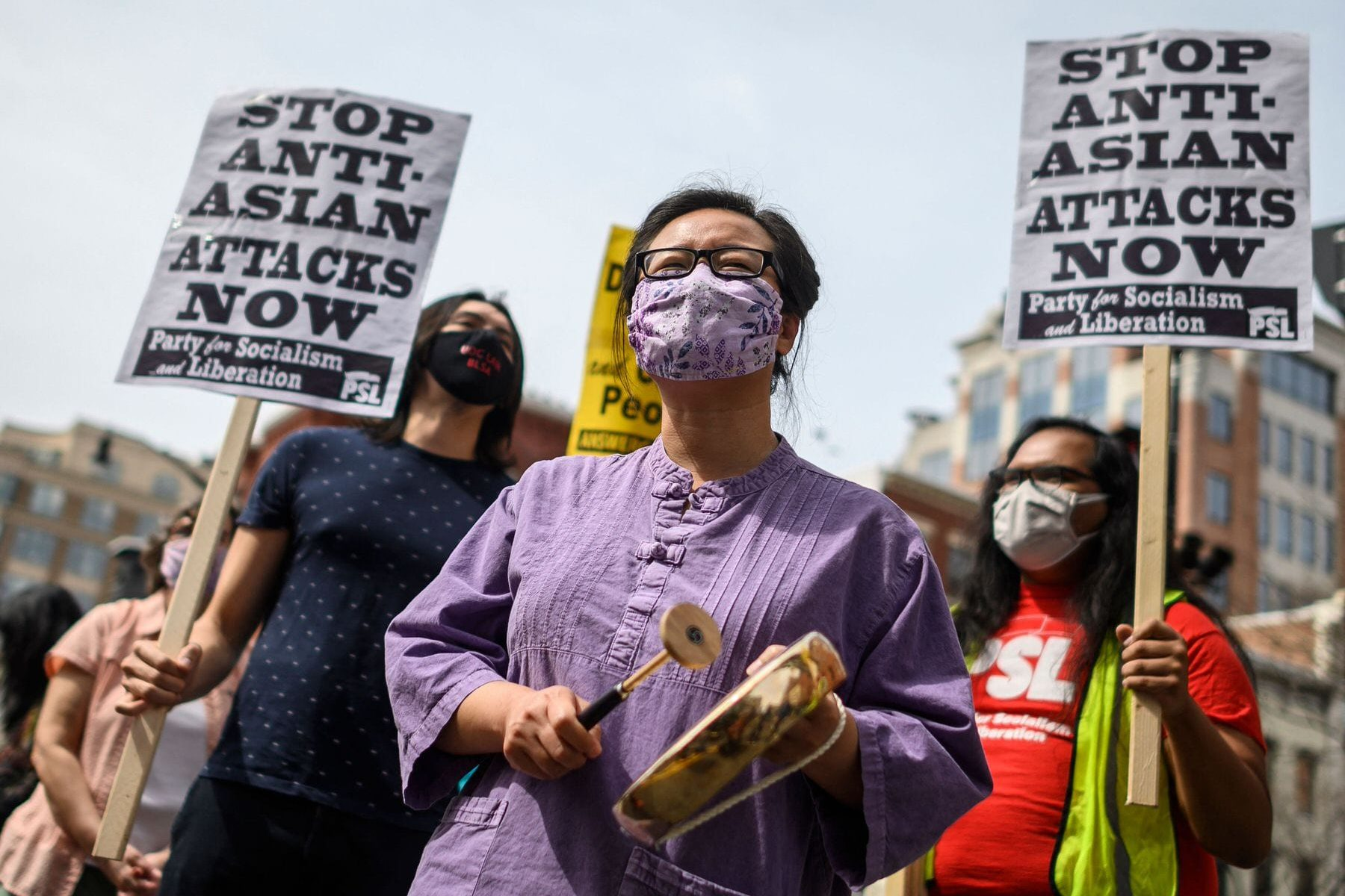 People participate in an 'Anti Asian Hate' rally in Chinatown in Washington, DC.