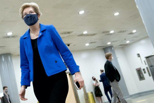 Elizabeth Warren walking while wearing a mask.