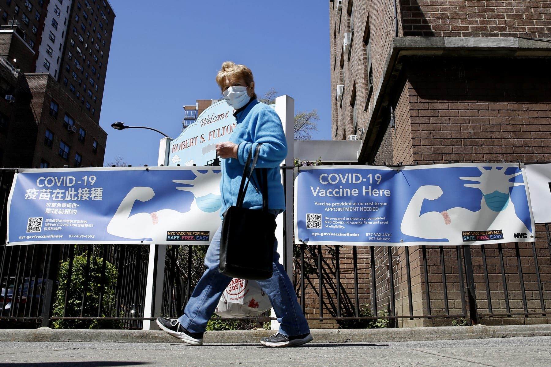 A woman walks near a Covid-19 Vaccination Center in New York City.