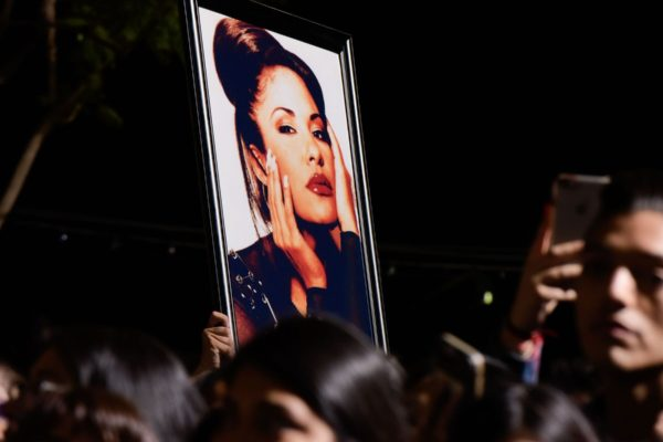 Fans hold up an image of Selena