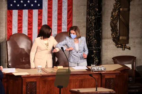 Harris and Pelosi greet each other ahead of the president's April jaddress
