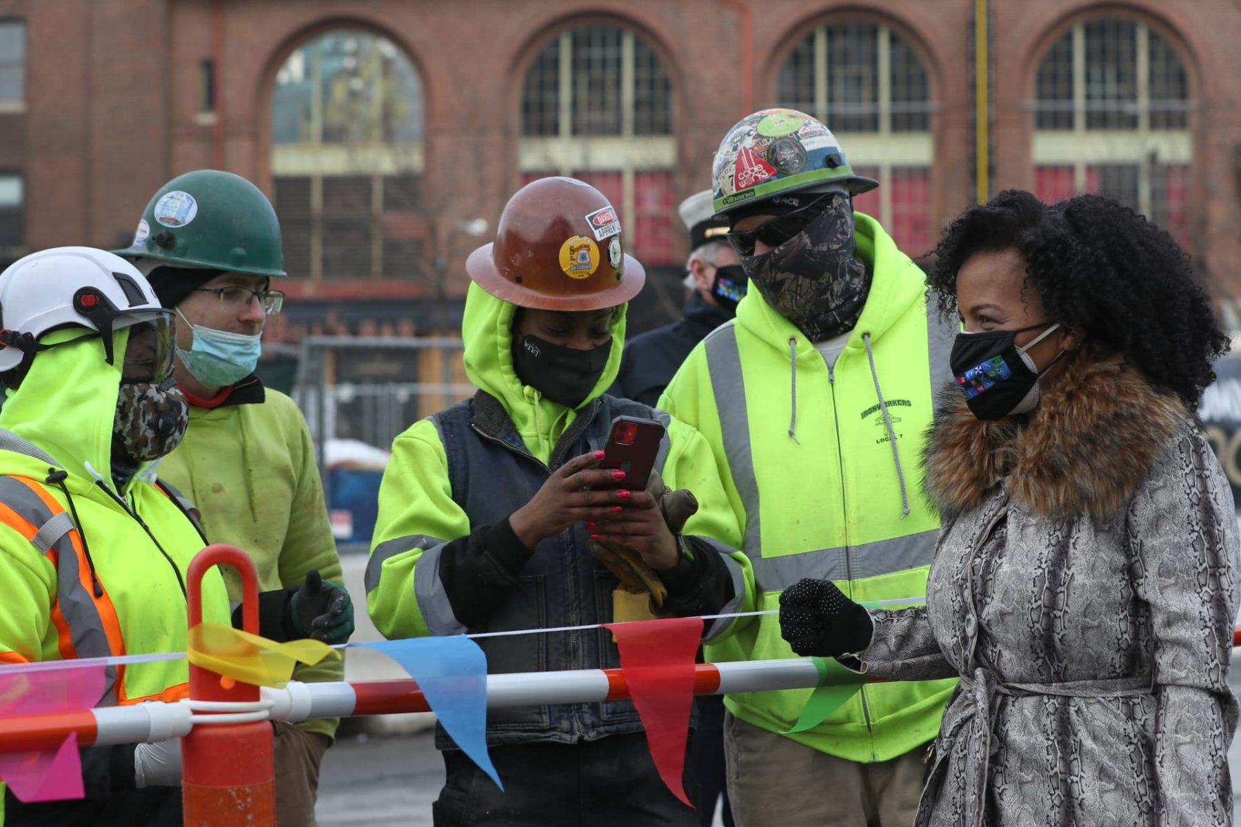 Kim Janey with construction workers in Boston
