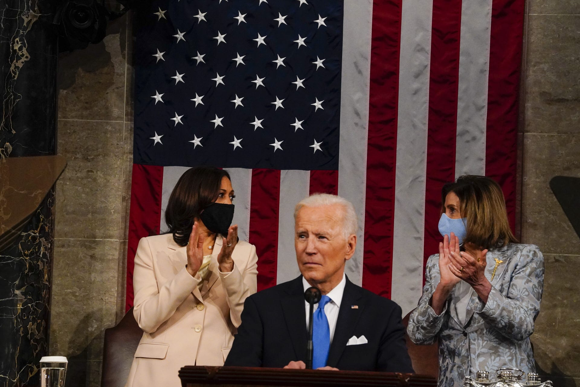 Harris and Pelosi stand behind Biden during speech