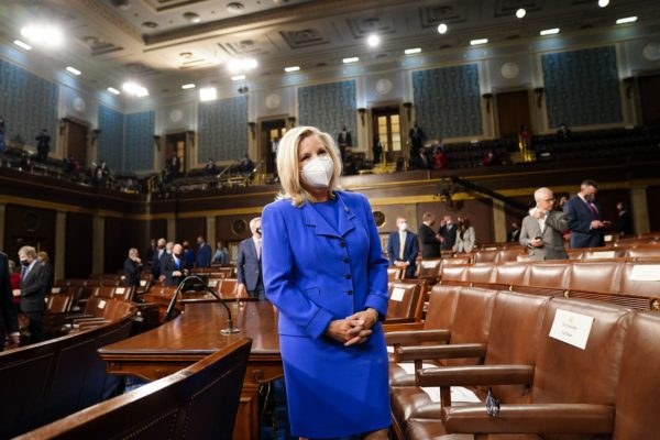 Rep. Liz Cheney (R-WY.) waits for the arrival of President Joe Biden before an address.