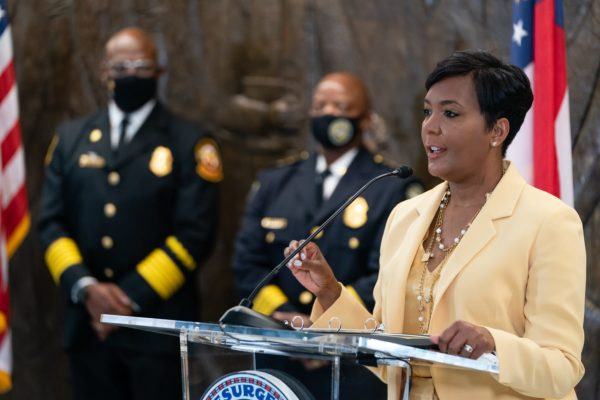 Atlanta Mayor Keisha Lance Bottoms speaks from a lectern at a news conference.