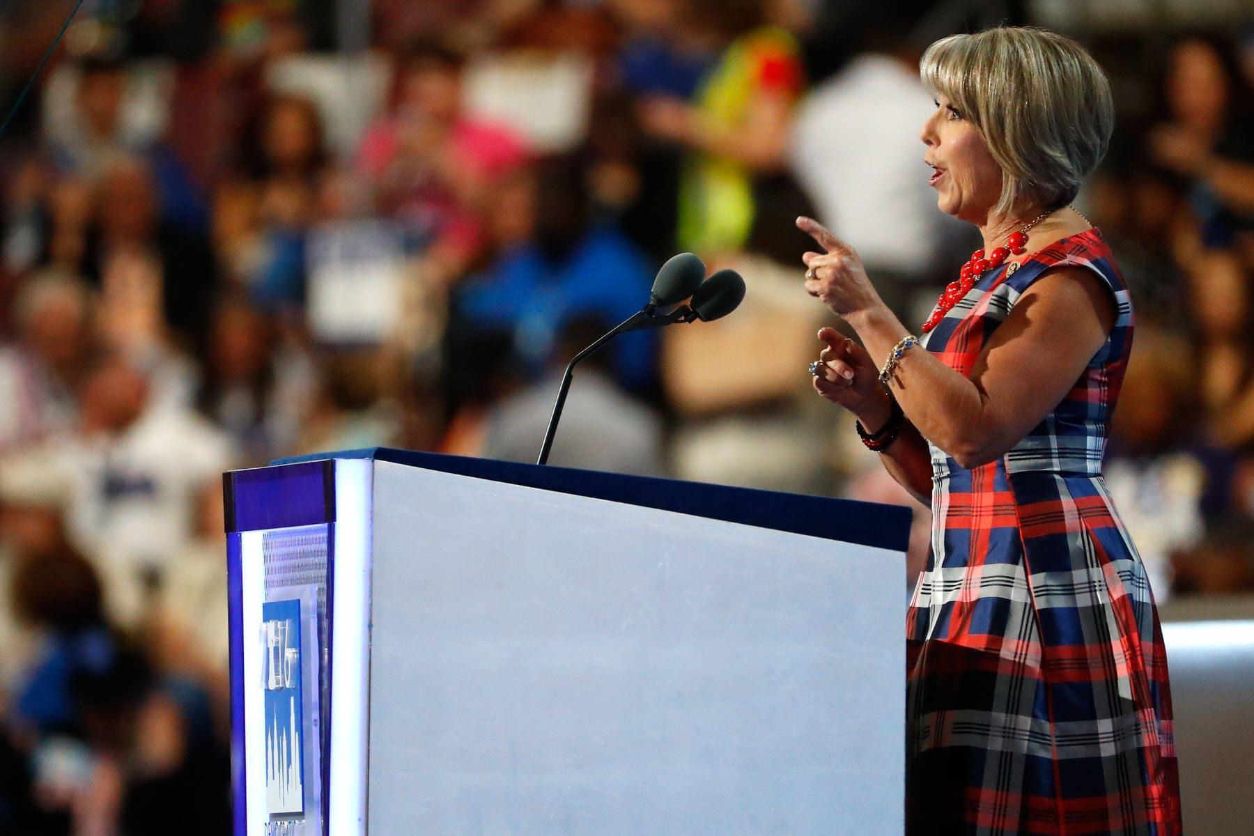 Gov. Michelle Lujan Grisham speaking at a podium.