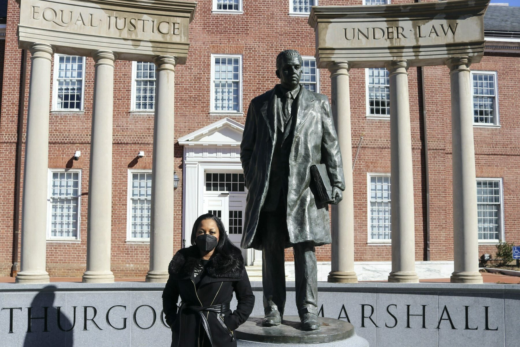 Maryland Del. Vanessa Atterbeary stands in front of a statue of Thurgood Marshall.