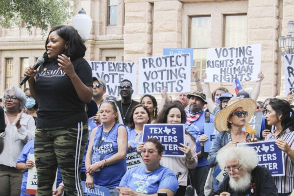 Representative Jasmine Crockett addresses the crowd at the For The People Rally in front of the Texas Capitol.