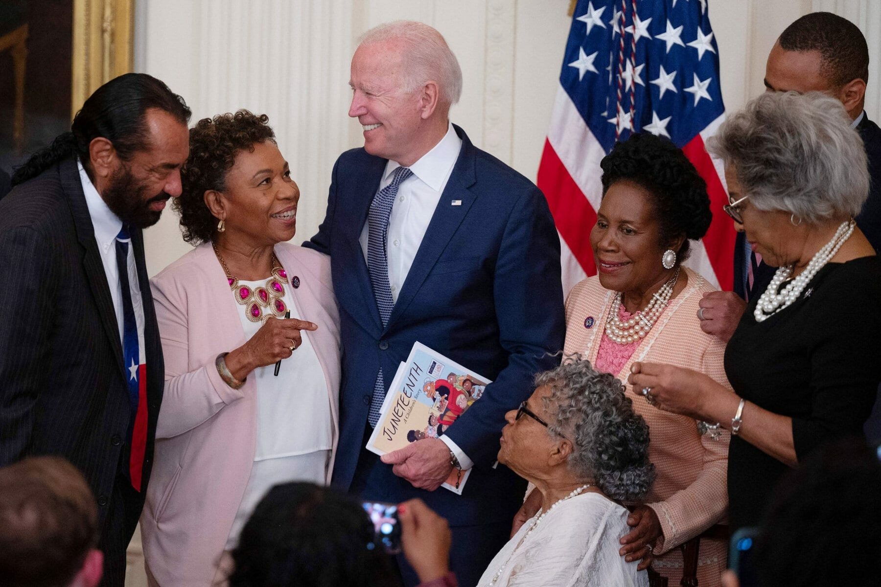 US President Joe Biden speaks with Opal Lee and guests in the White House.