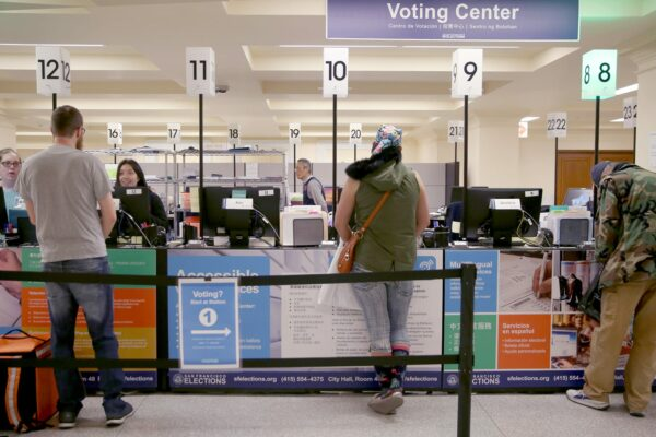 Voters being helped at a city hall voting center.