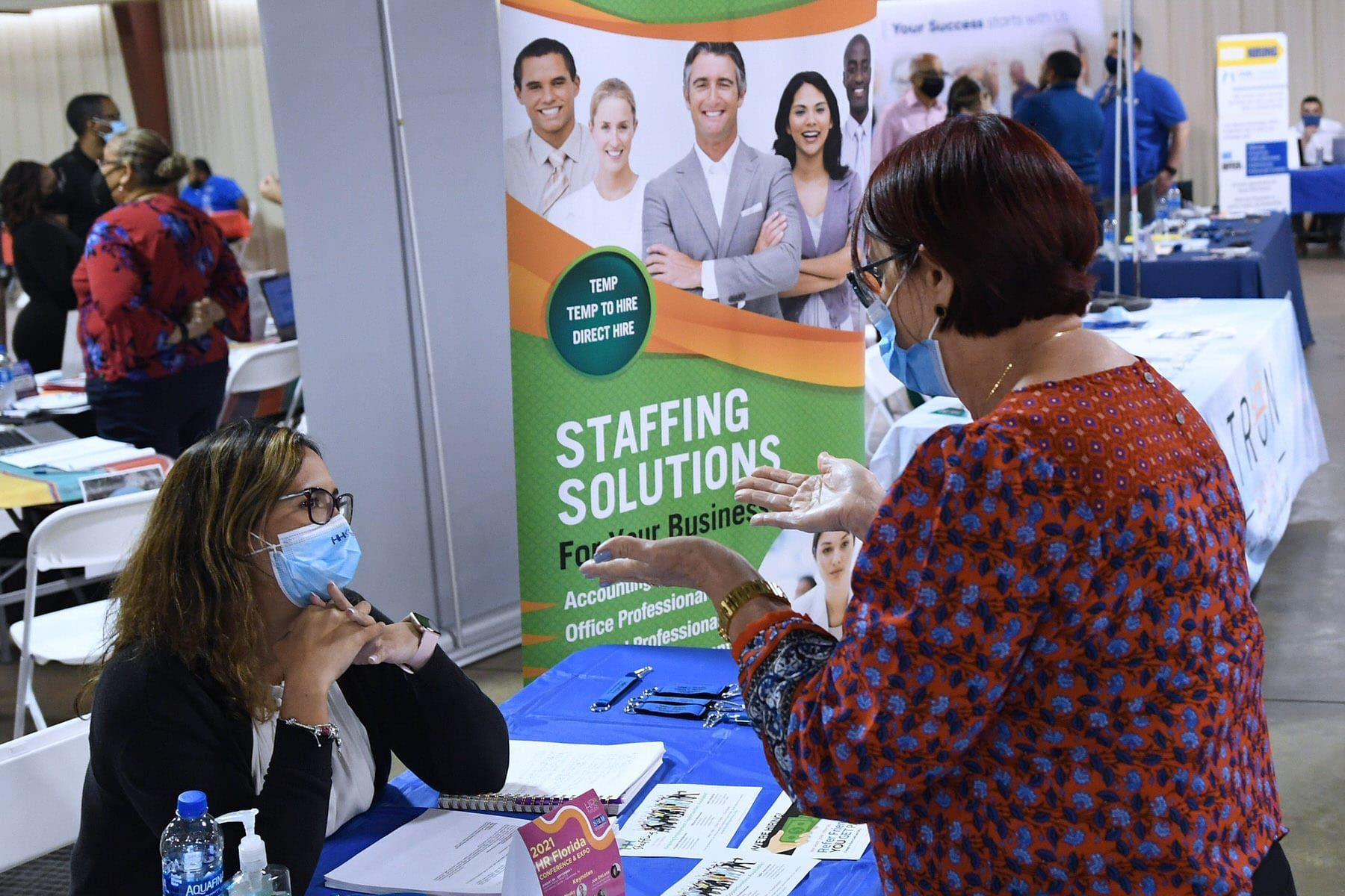 A woman seeking employment speaks to a recruiter at the 25th annual Central Florida Employment Council Job Fair at the Central Florida Fairgrounds. More than 80 companies were recruiting for over a thousand jobs.