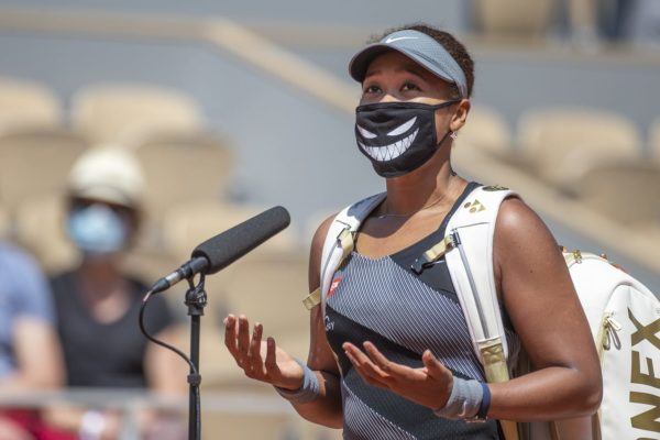 May 30. Naomi Osaka of Japan conducts an on court interview wearing a mask after her victory against Patricia Maria Tig of Romania in the first round of the Women's Singles competition on Court Philippe-Chatrier at the 2021 French Open