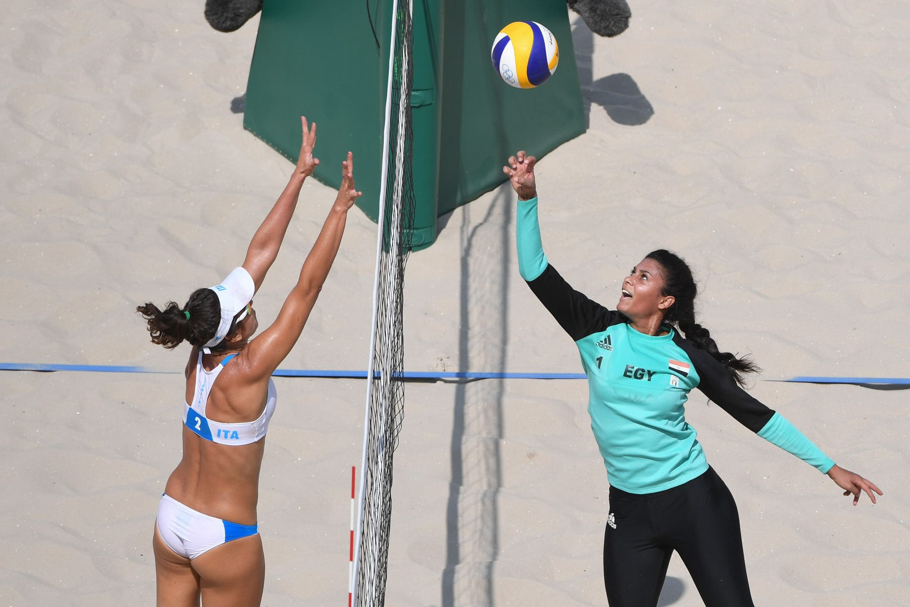 Nada Meawad (R) from Egypt in action against Laura Giombini (L) from Italy during the Women's Preliminary Pool Beach Volleyball match.