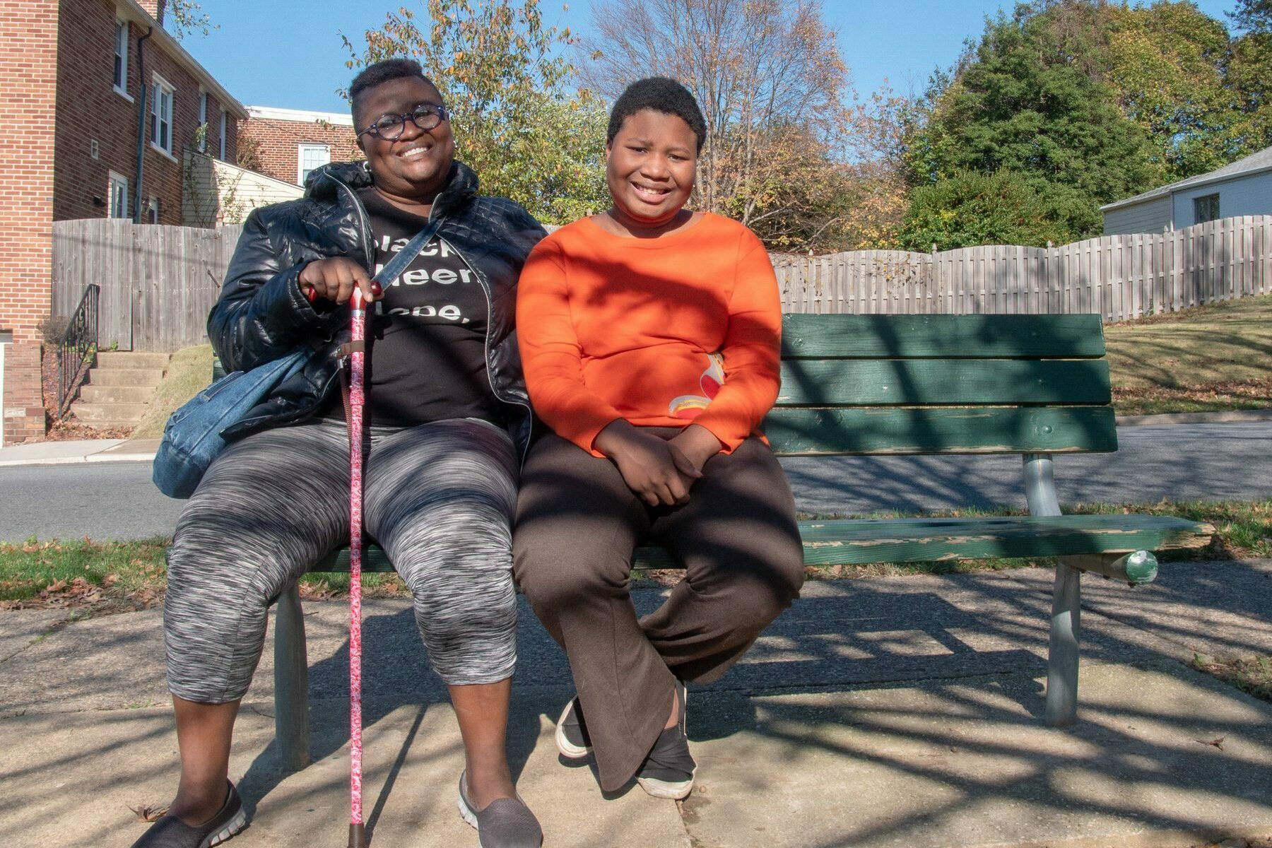 DeShanna Neal and her daughter Trinity Neal, on a park bench.