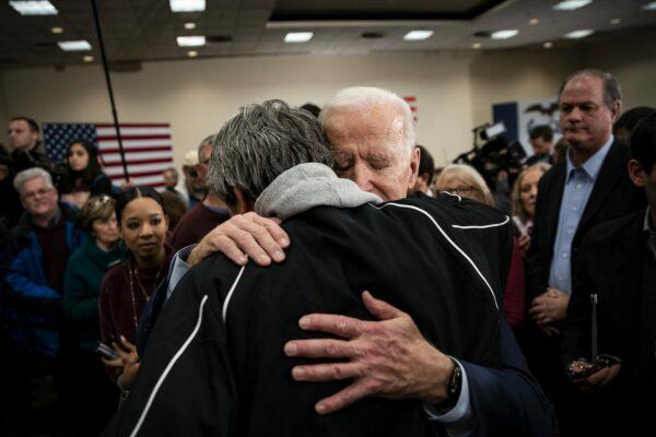 US President Joe Biden hugs an attendee during an event on January 21, 2020 in Ames, Iowa.
