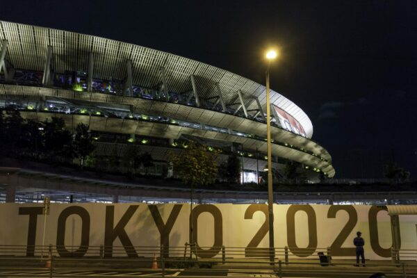 The outside of the Olympic Stadium in Tokyo at night.