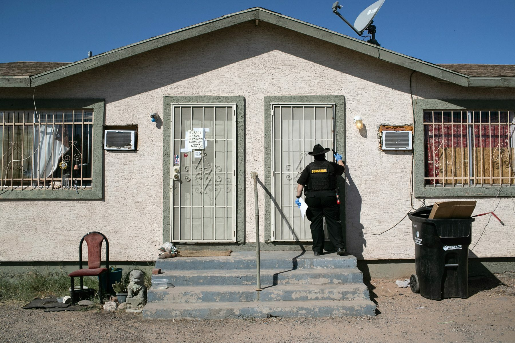 Maricopa County constable knocks on a door before posting an eviction order.