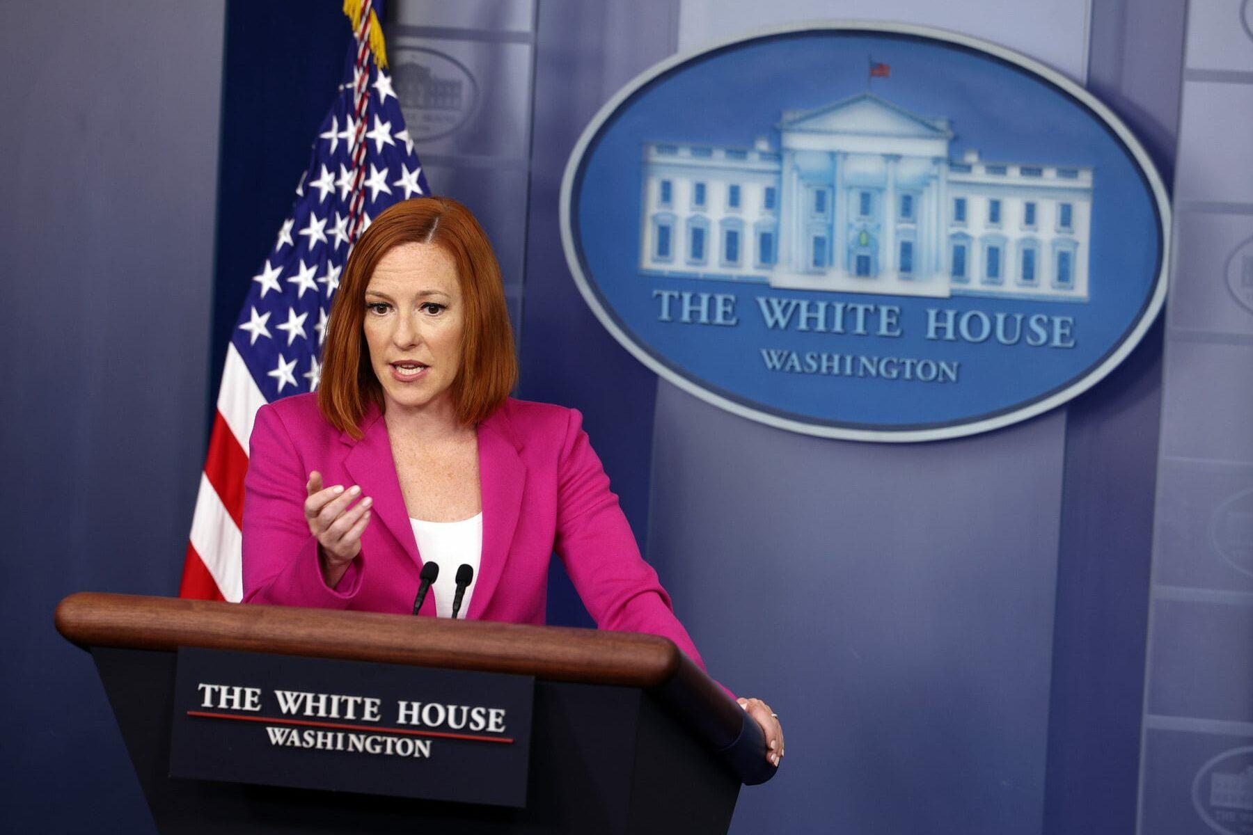 White House Press Secretary Jen Psaki stands at a podium.