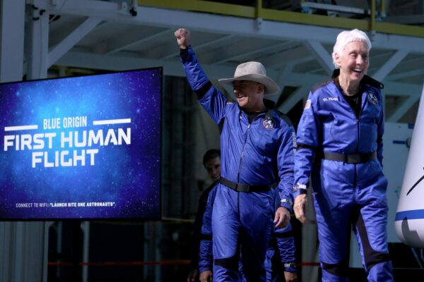 Blue Origin's New Shepard crew (L-R) Jeff Bezos and Wally Funk arrive for a press conference after flying into space.