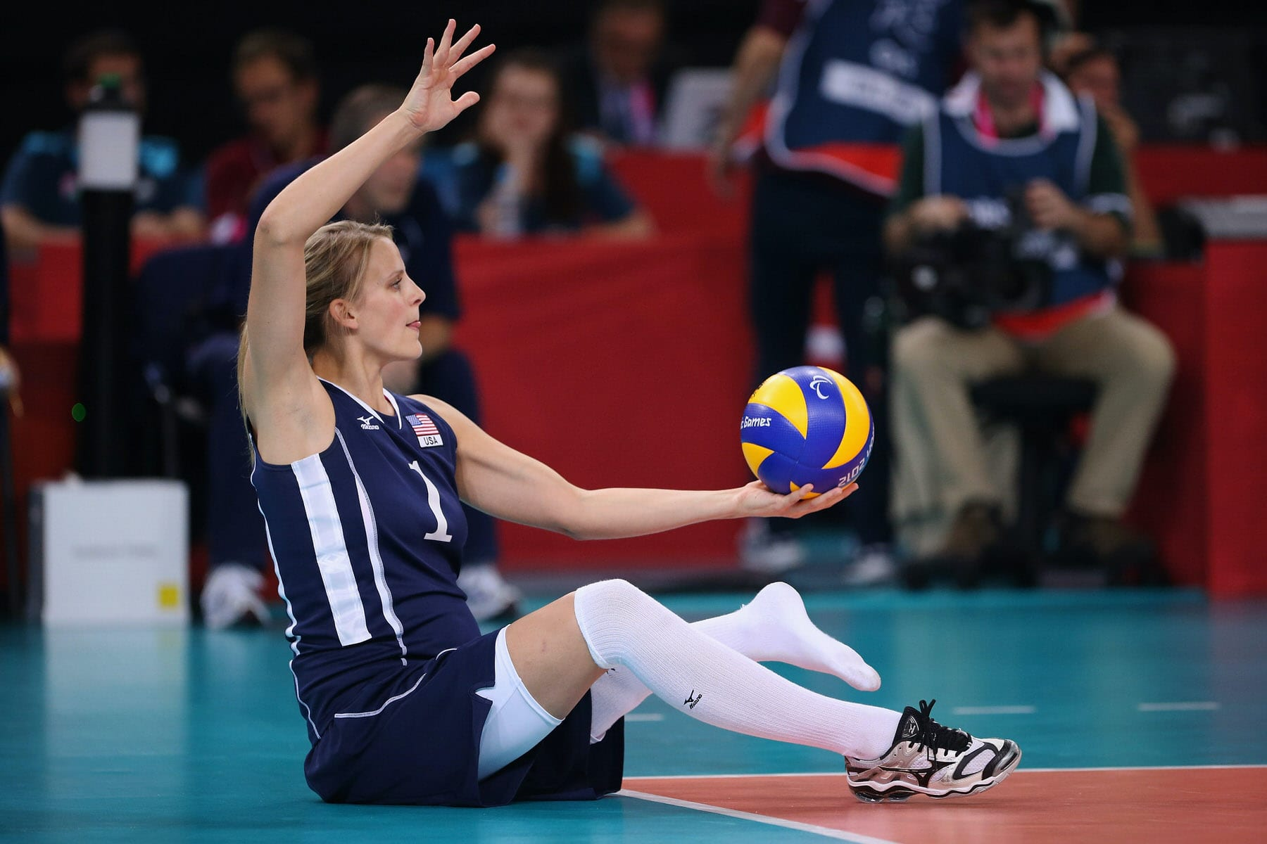 American volleyball player Lora Webster plays in a sitting volleyball game.