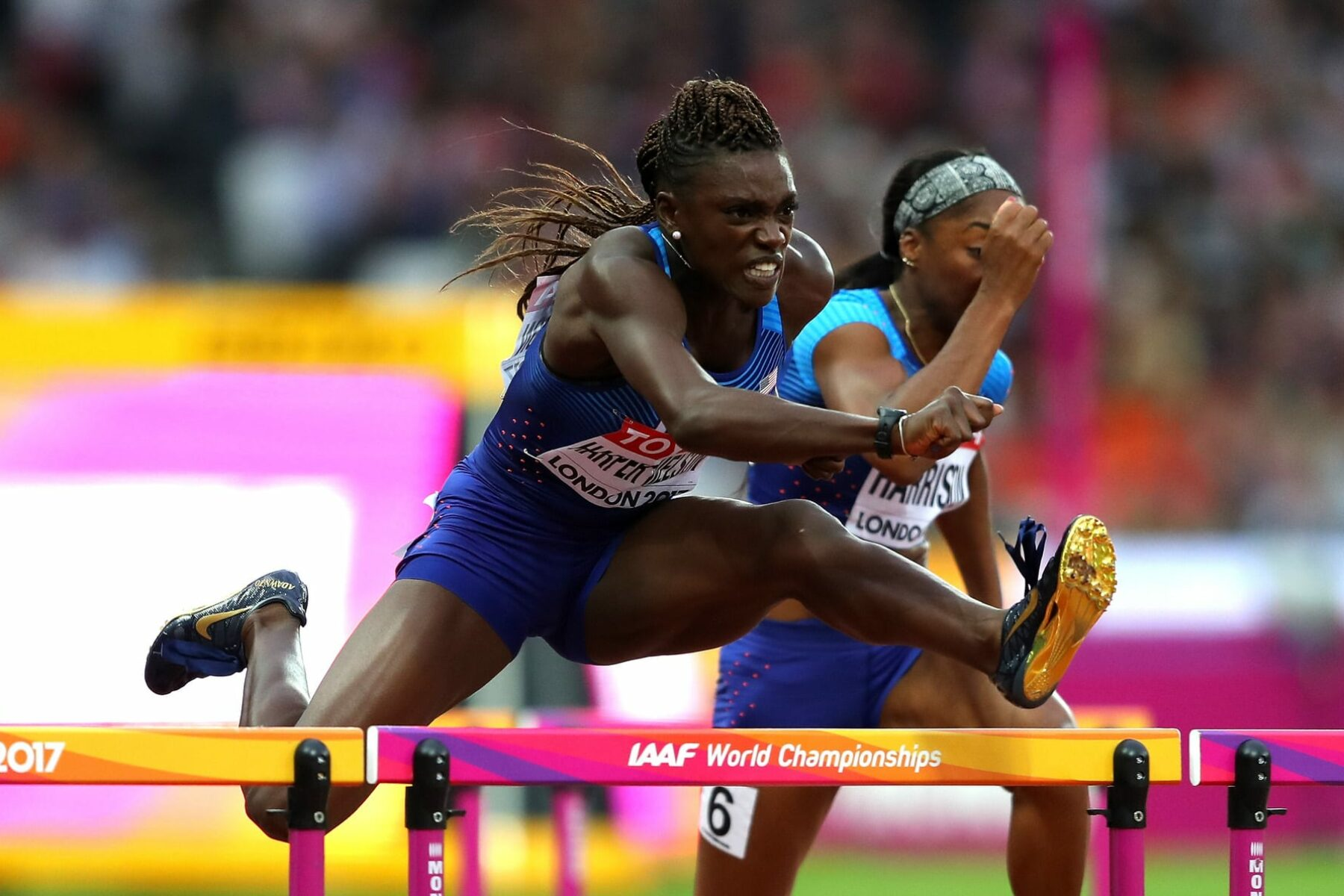 Dawn Harper-Nelson jumping over a hurdle.