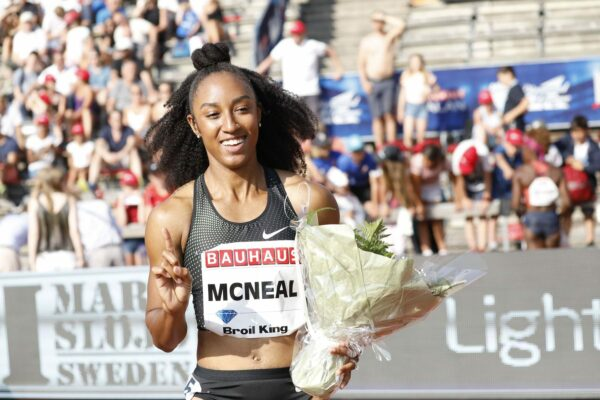 Brianna McNeal from USA, reacts after winning the women's 100m hurdles.