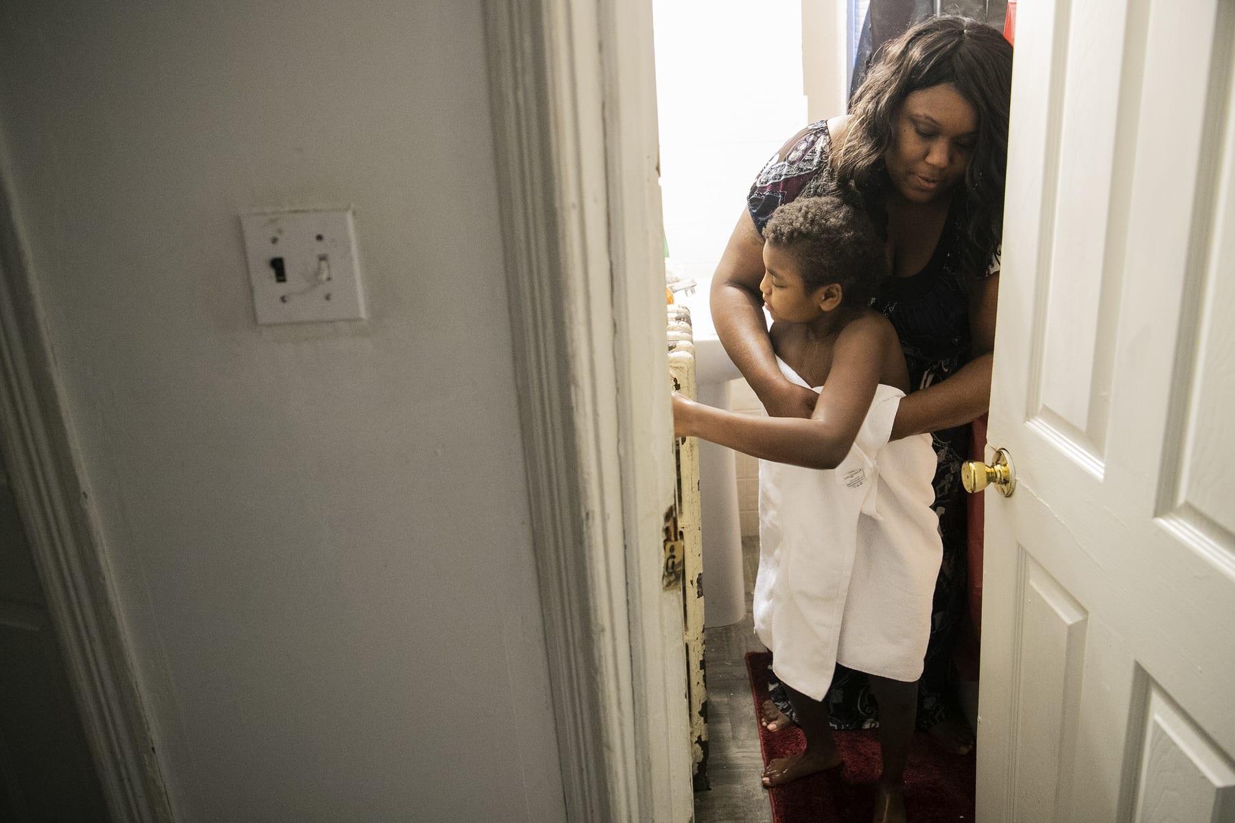 Syrita Powers helping dress her daughter Georgia.