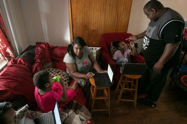 Syrita Powers and her family pictured at home in their living room.
