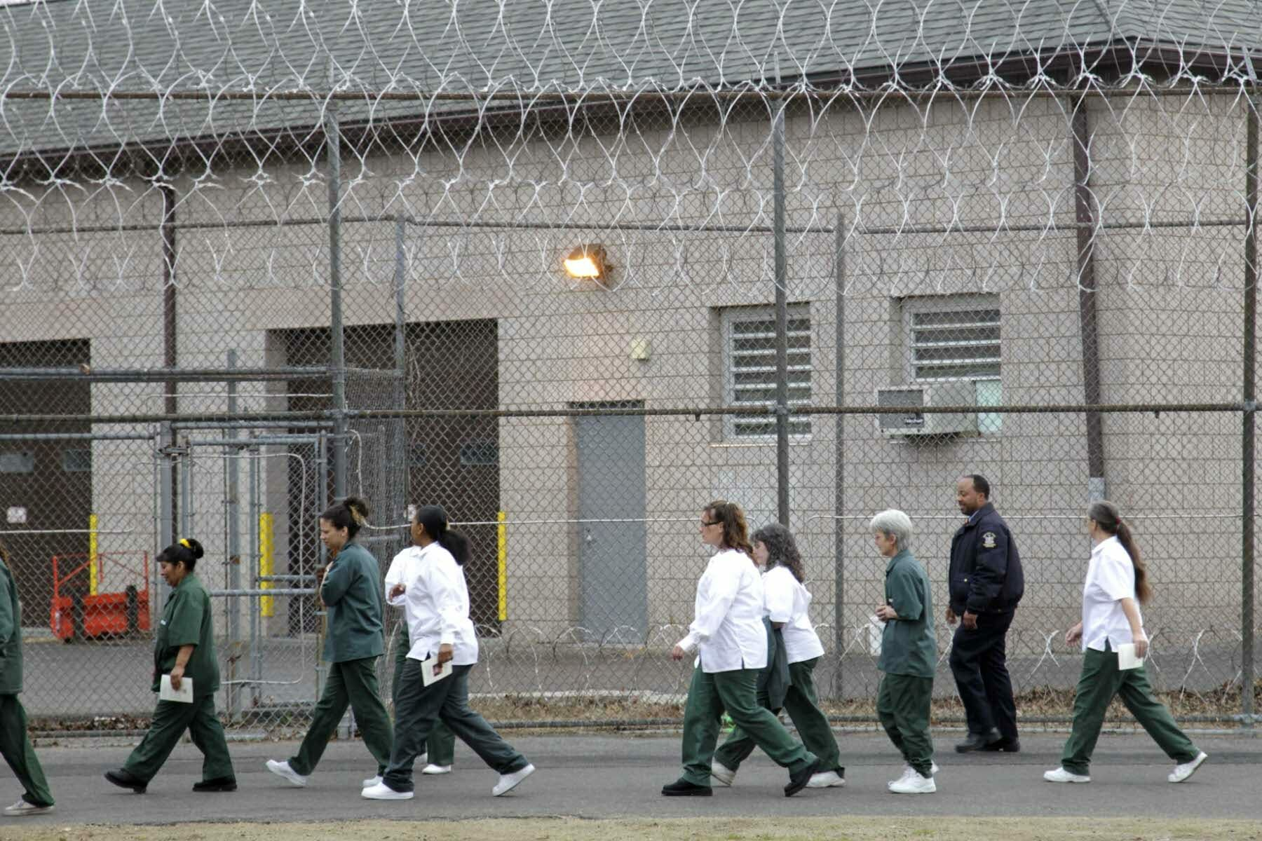 Women walk on a road at the women-only Taconic Correctional Facility in Bedford Hills, N.Y., Wednesday, March 28, 2012. (AP Photo/Seth Wenig)
