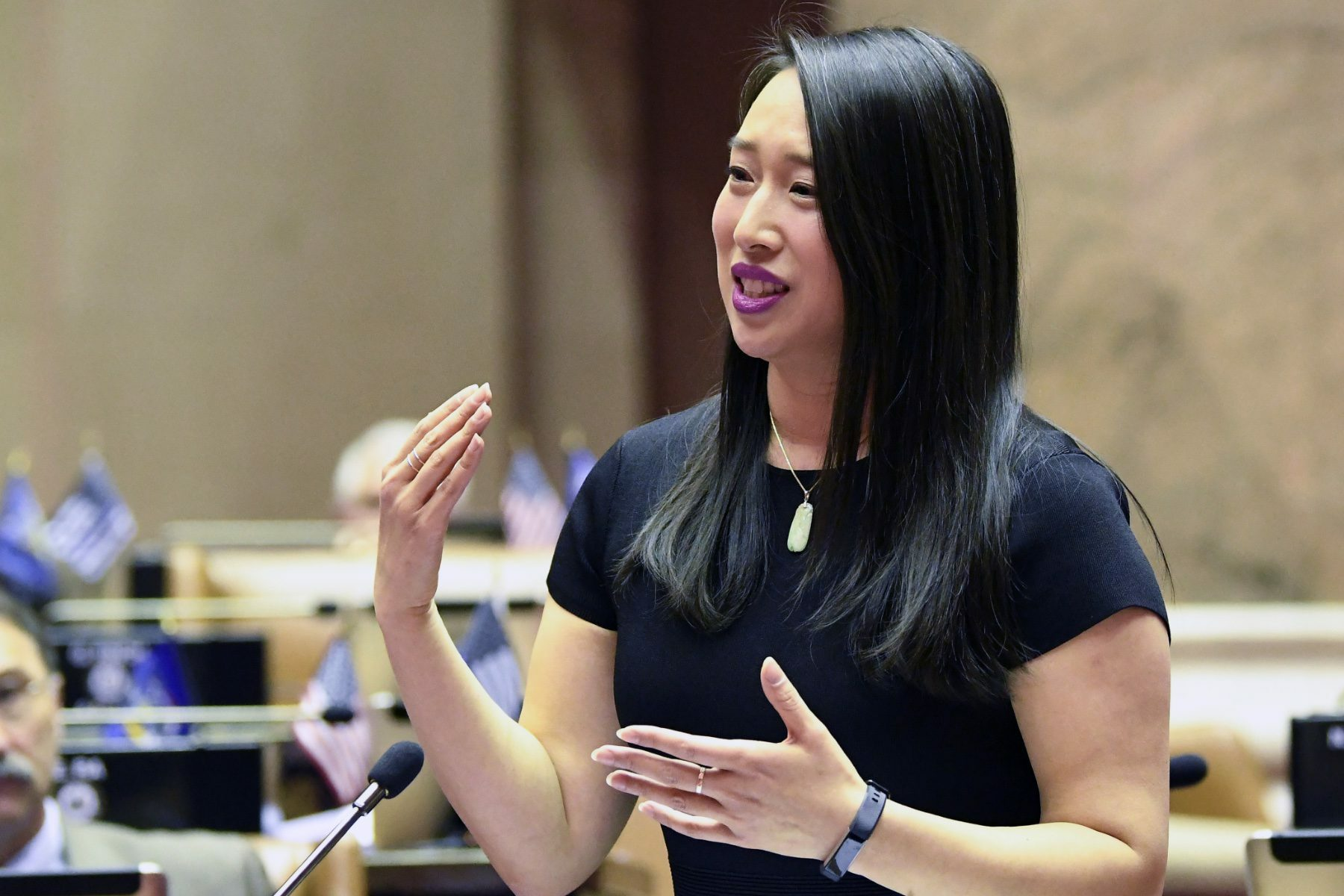 New York Assemblywoman Yuh-Line Niou speaking at a podium.