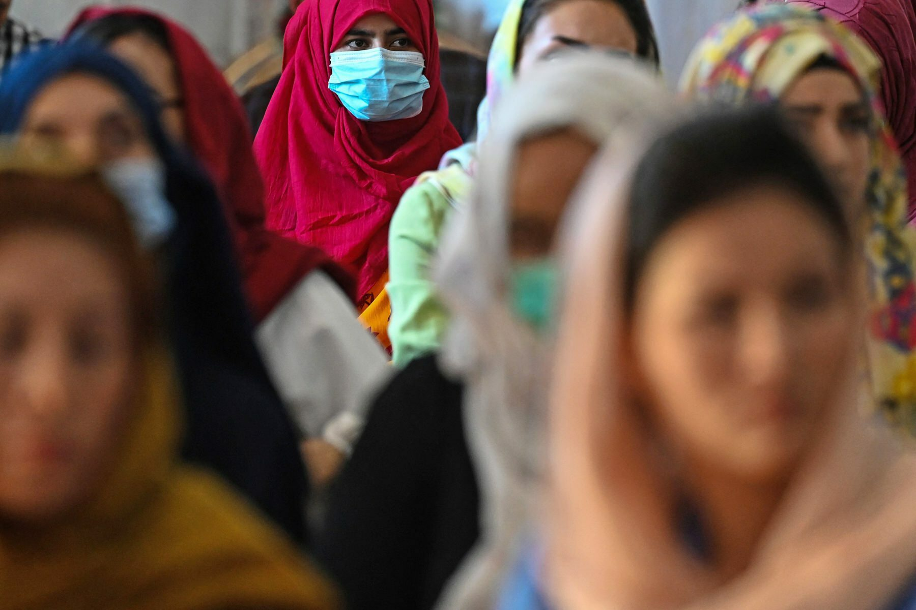 Afghan women take part in a gathering at a hall in Kabul.