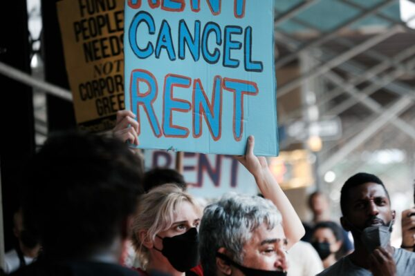Protester holding a sign that says cancel rent.