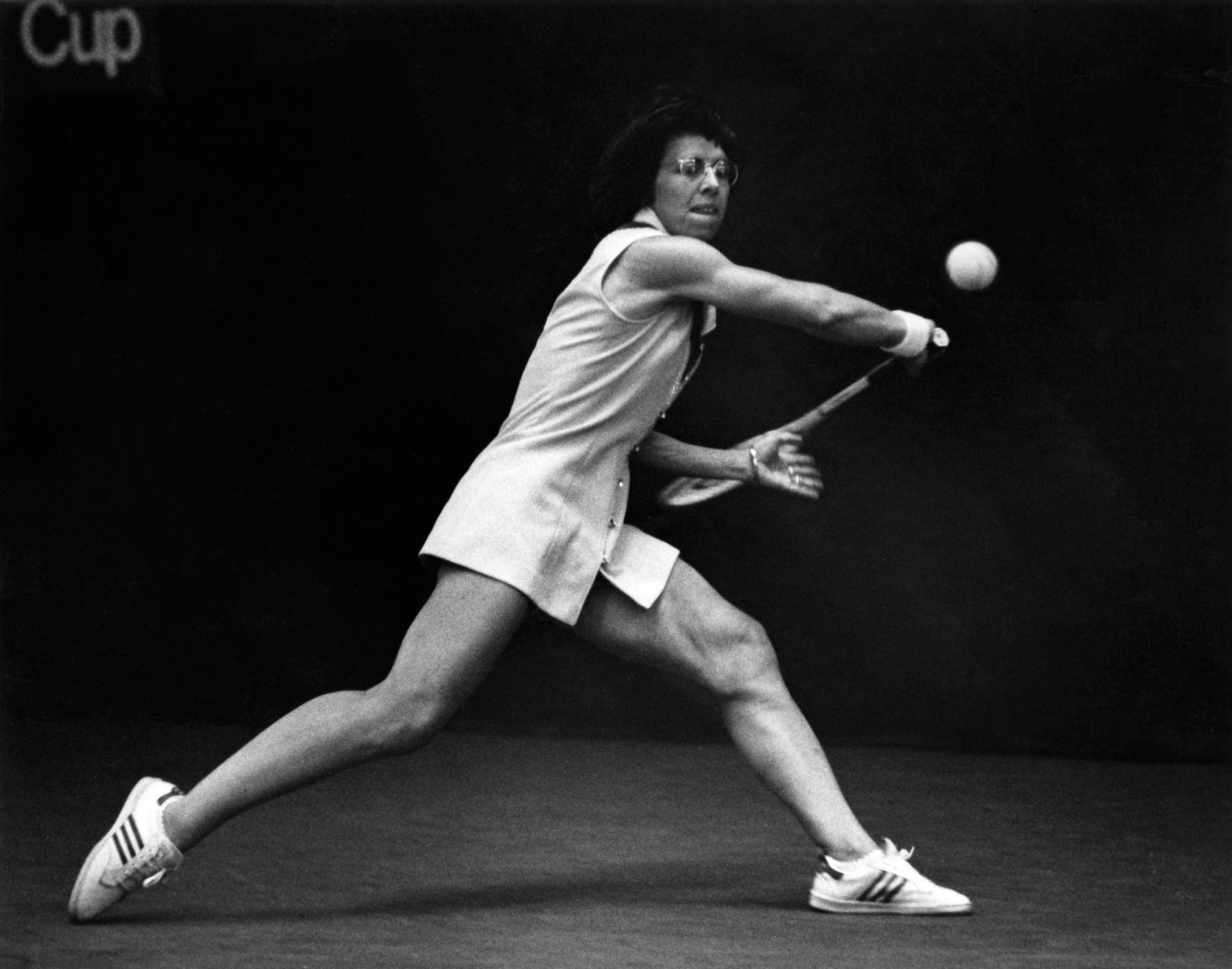 Black and white photo of Billie Jean King playing tennis.
